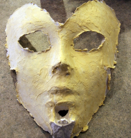 Applying Elmer's Wood Filler to Paper Mache Mask