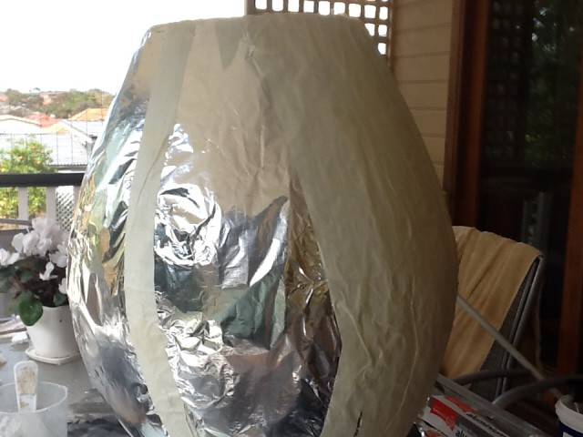 Armature covered with foil then covered with masking tape.